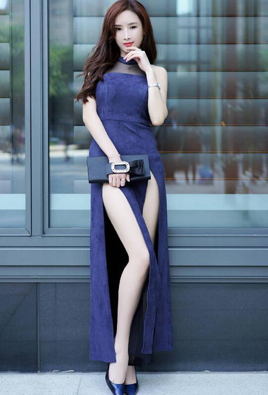 身材修长的美女小姐姐穿紫色旗袍 没想到还挺好看的